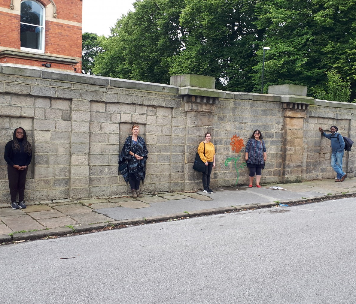 Artists in front of the boundary wall